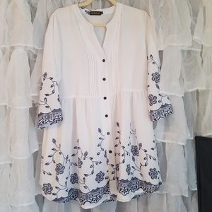 Reborn white tunic with blue floral design